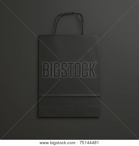 Black Paper Bag On Black Background With Handles