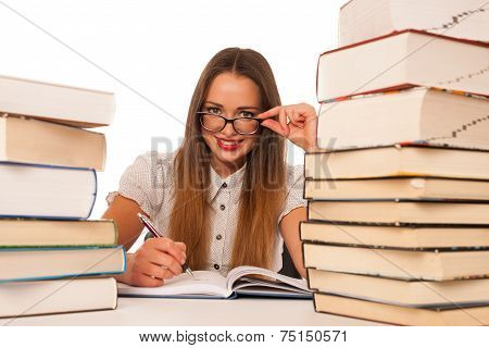 Happy Asian Caucasian Girl Lerning In Study Woth Lots Of Books On The Table