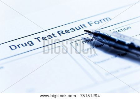 Drug test blank form with pen