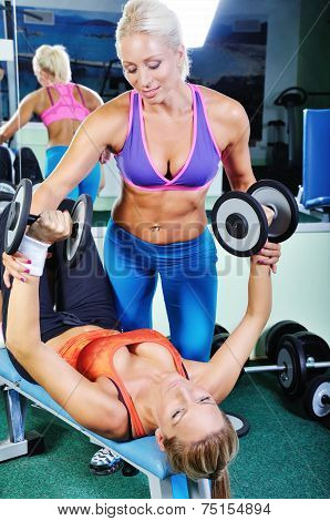 Beautiful Women Exercising With Personal Fitness Trainer
