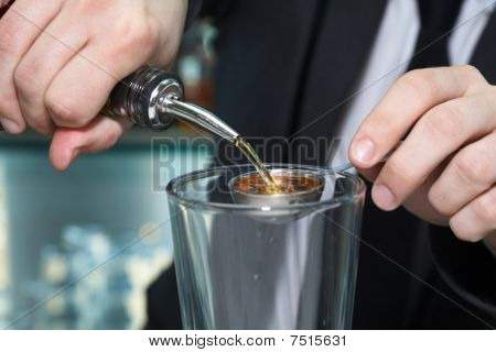 Bartender Pouring Alcohol In Measuring Spoon