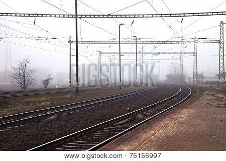 Railroad tracks in the fog