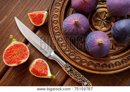 figs in a bowl and on rustic wooden table