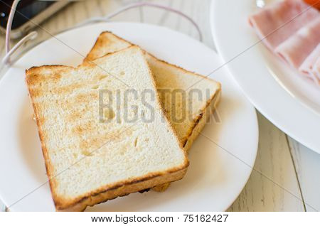 Breakfast With Toasts And Pork Sliced Ham