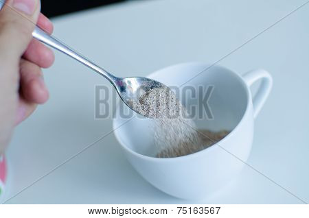 Instant Coffee With Spoon And Coffee Cup