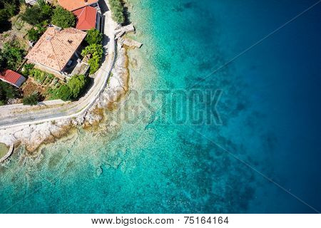 Sea shore and building roof at sunny day