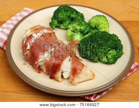 Chicken breast stuffed with cheese sauce and wrapped in pancetta.