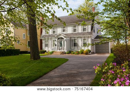 An older style traditional home with a springtime garden.
