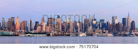 New York City Manhattan sunset panorama with historical skyscrapers over Hudson River viewed from New Jersey Weehawken waterfront at dusk with tranquil blue tone.