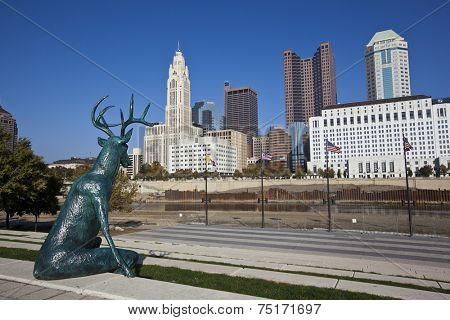 COLUMBUS, OHIO-OCTOBER 25, 2014:  This bronze deer statue designed by artist Terry Allen sits along the bank of the Scioto river.