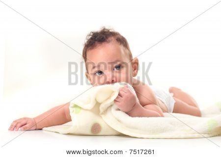 Infant Boy On Stomach Playing With Blankets