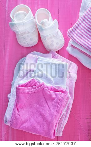 baby clothes for baby girls on the table, children white