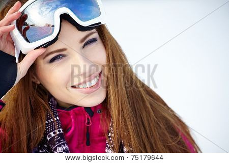 Portrait of woman in winter scenery