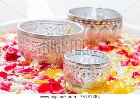 Water In Bowl Mixed With Perfume And Vivid Flowers Corolla For Songkran Festival In Thailand.