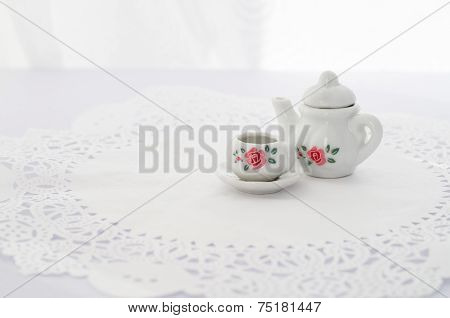 Retro toy tea set - a cup, a saucer and a tea pot