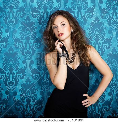 Beautiful Gorgeous Model Posing In Blue Vintage Room