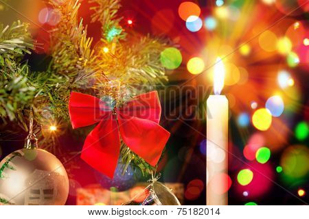 Candle And Ornaments On Christmas Tree