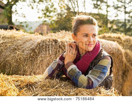 Happy Young Woman Near Haystack