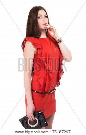 Portrait Of Brunette Posing In Red Dress
