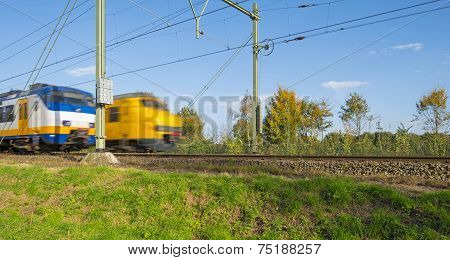 Passenger trains passing at high speed
