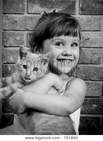 Two-year old girl with a kitty