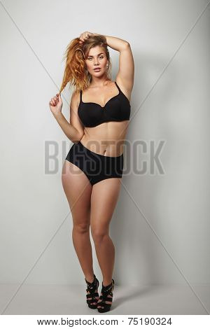 Confident Plus Size Woman Posing In Bikini