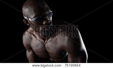 Swimmer Wearing Goggles Looking Over Shoulder