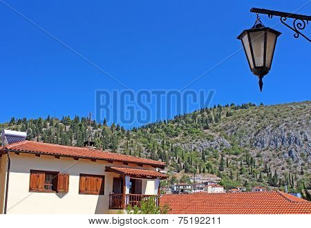 Stone Traditional House And Lantern In Kastoria City (Epirus, Greece)