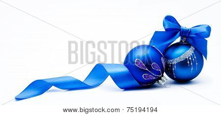 Two Blue Christmas Ball With Ribbon Isolated
