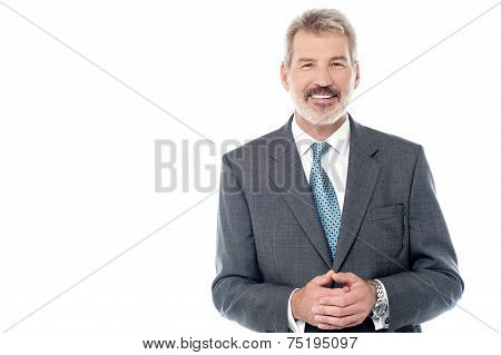 Businessman In Suit With Hands Clasped