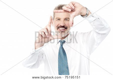 Business Man Making Frame With His Hands