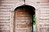 stock photo of front-entry  - Architecture detail with a very old wooden house front door  - JPG