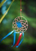 stock photo of dreamcatcher  - Beautiful handmade dreamcatcher in the forest outdoor  - JPG