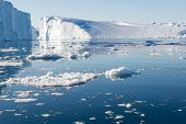 pic of iceberg  - Beautiful Icebergs in Disko Bay Greenland around Ilulissat with blue sky - JPG