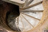 pic of spiral staircase  - Tight concrete steps work up a spiral staircase to the top of a lighthouse - JPG