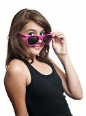 image of teen pony tail  - Portrait of cute teen girl with pony tails and sun glasses looking at camera on white background - JPG