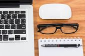 foto of field mouse  - Blank business laptop mouse pen note and glasses on wooden table  - JPG