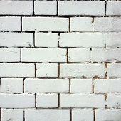 pic of crude  - Detail of a crude whitewash paint job on an external brick wall - JPG