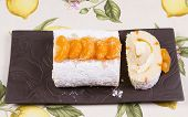 foto of satsuma  - Orange flavoured Swiss roll decorated with orange slices