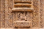 stock photo of sun god  - The figure of an Indian king carved into the wall of the ancient Sun Temple at Konark in the state of Orissa - JPG