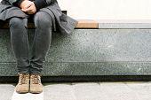 foto of slender legs  - Trendy hipster resting in the city beautiful slender female legs in winter - JPG