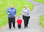 stock photo of obesity children  - Overweight parents with her son running together - JPG