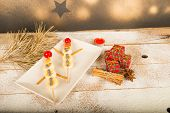 stock photo of christmas meal  - Fruity Christmas dessert set up and decorated as a kid meal - JPG