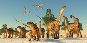 stock photo of pterodactyl  - Quetzalcoatlus flying reptiles join Tenontosaurus and Argentinosaurus dinosaurs on a migration in search of water - JPG
