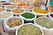 stock photo of oman  - Nuts spices and pulses in the souq of Nizwa Oman - JPG