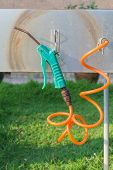 foto of air compressor  - Air compressor gun with coiled orange for golf shoes blower - JPG