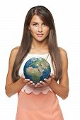 image of continent  - Smiling business woman holding earth globe in her hands - JPG
