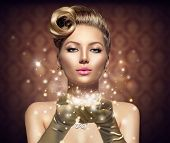 pic of blow-up  - Holiday Retro Woman blowing magic dust in her hand - JPG