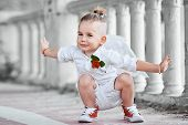 picture of little angel  - Little boy with angel wings on old city background - JPG