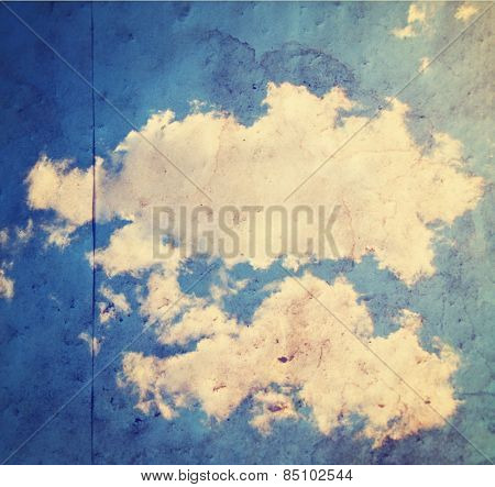 paper texture background with a clouds image overlay toned with a retro vintage instagram filter app or action effect